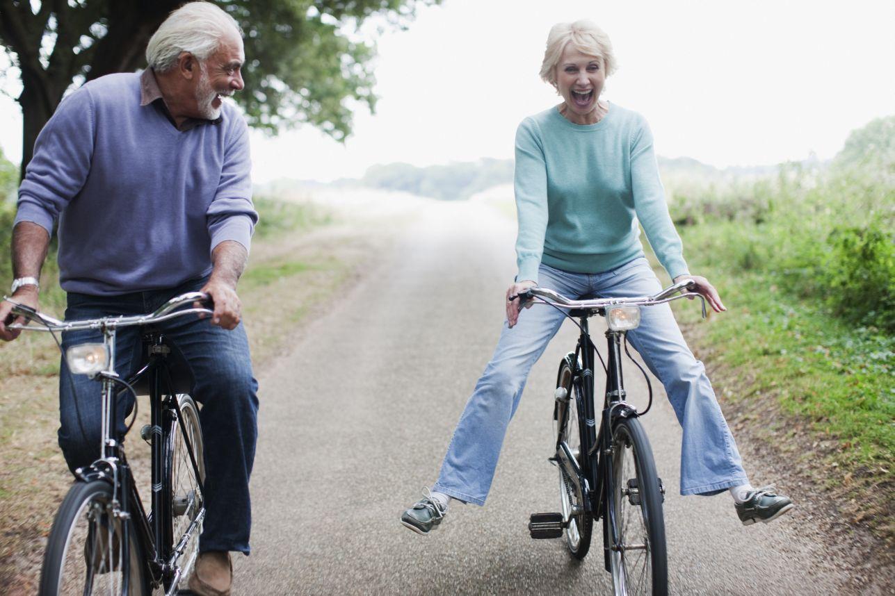 Two seniors on bikes