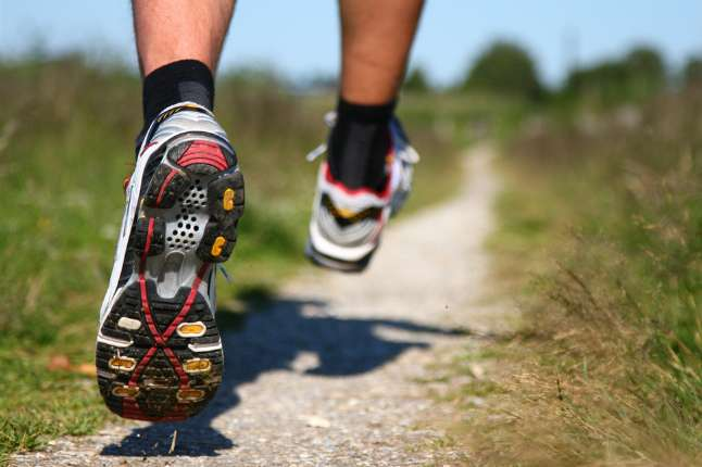 Closeup of someone running in running shoes