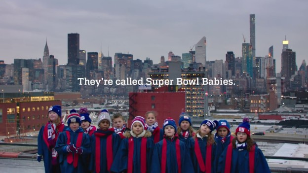 Group of young children in NY Giants merch in front of NYC skyline