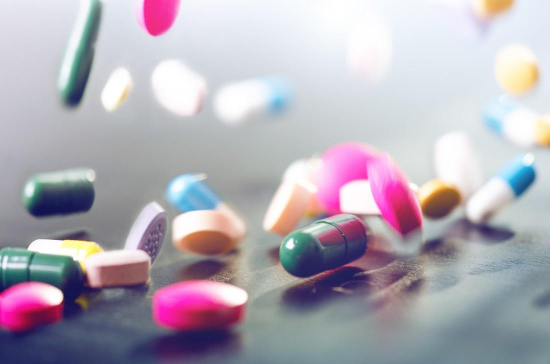 Levitation of pills on a black background