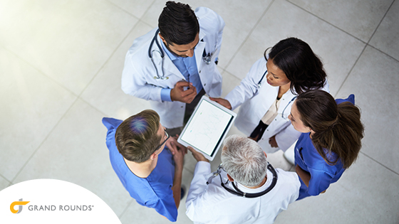 5 doctors looking at medical results