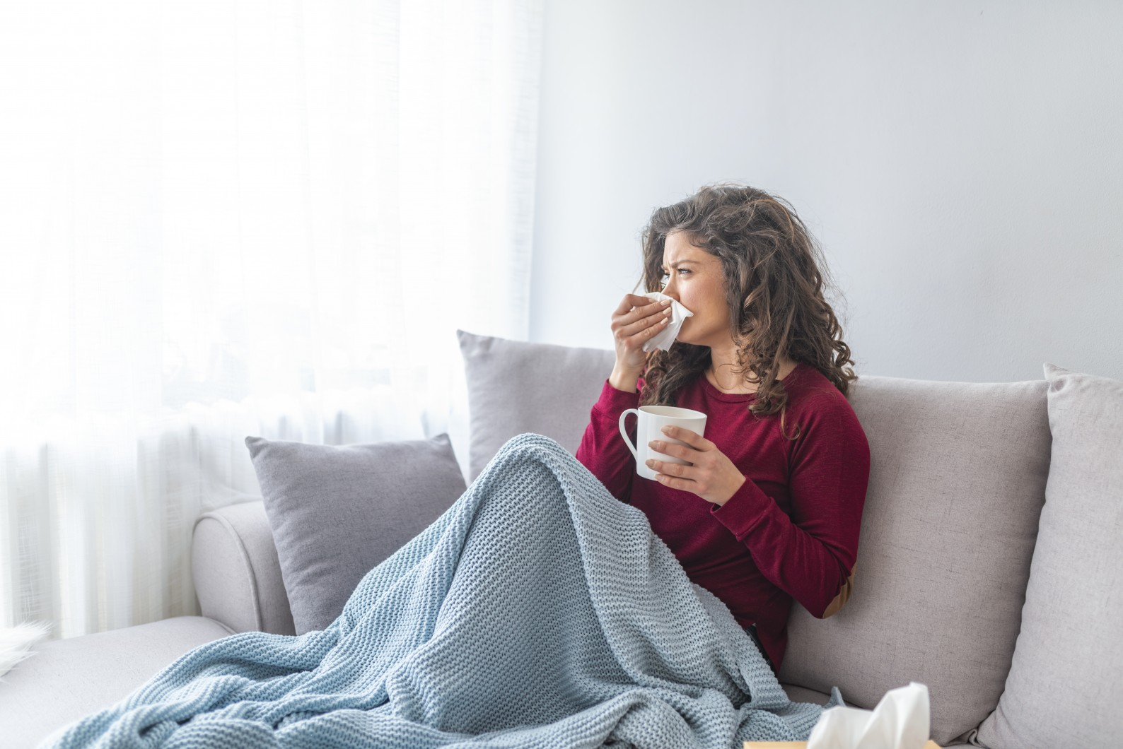 Woman with flu in bed