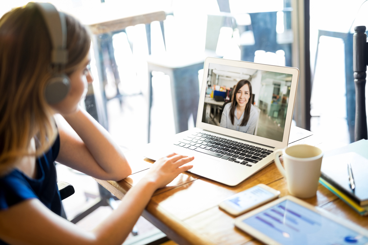 Woman at home in video call