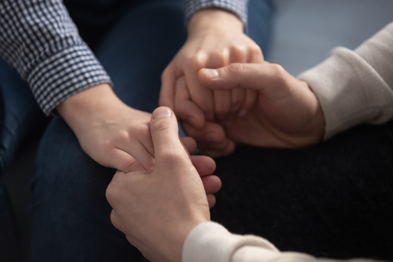 Close up of man and woman happy couple hold hands show love and care, promise loyalty and understanding