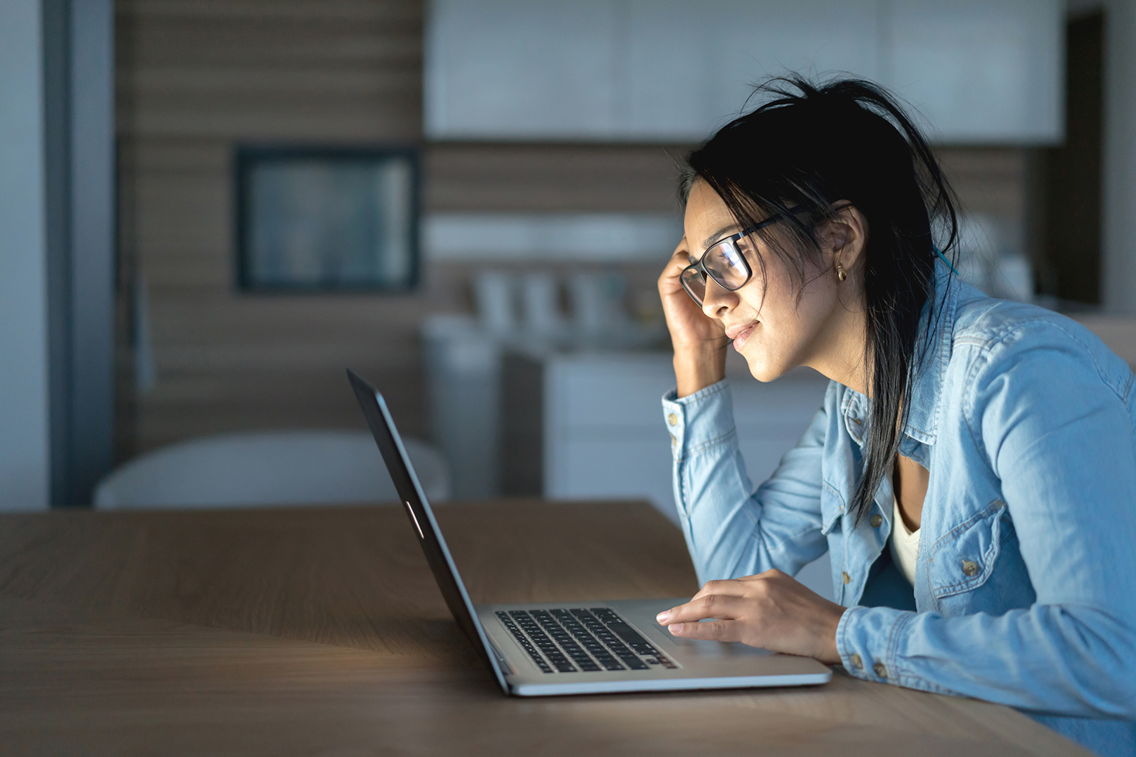 Woman at home on laptop