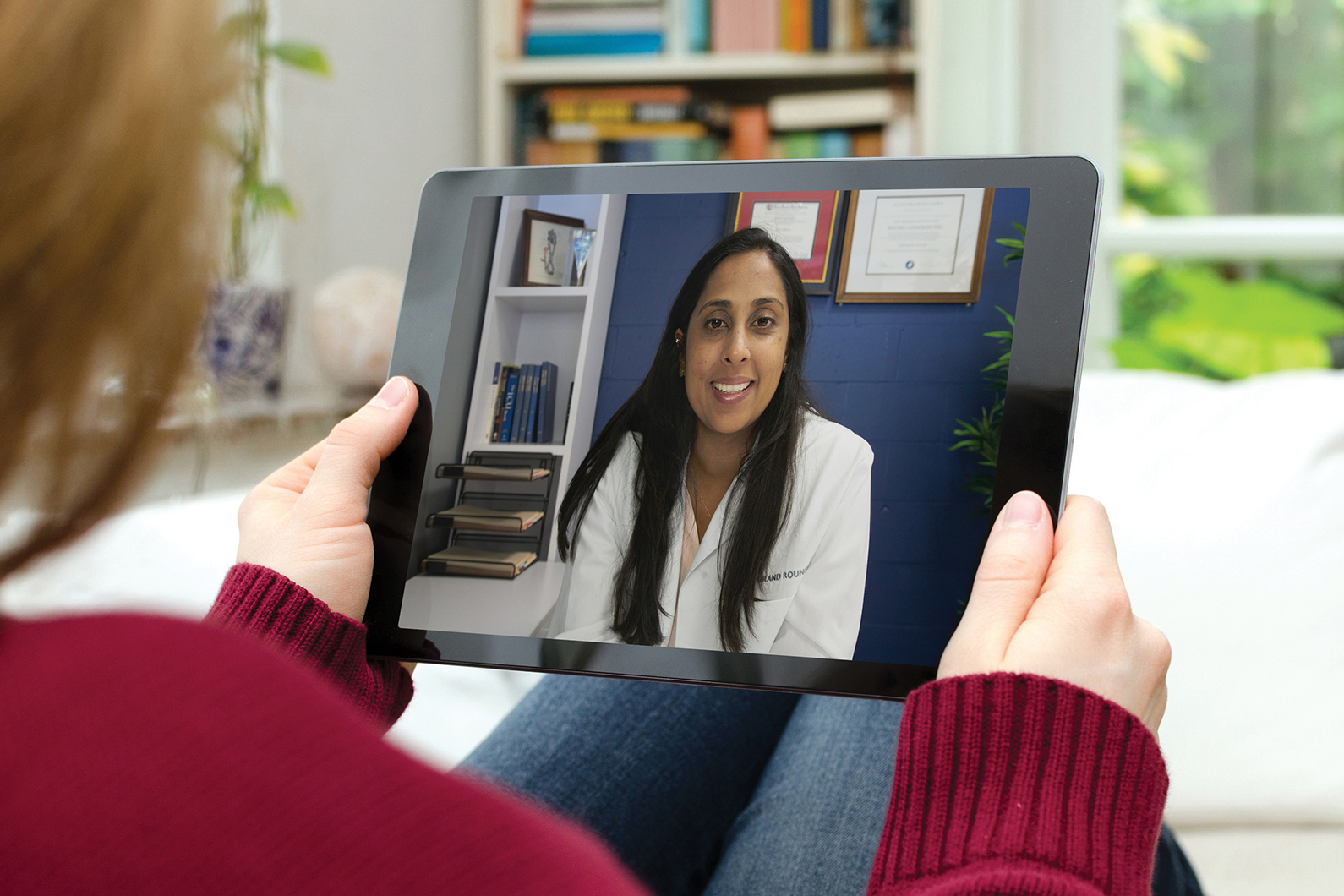 Woman at home in video call on tablet