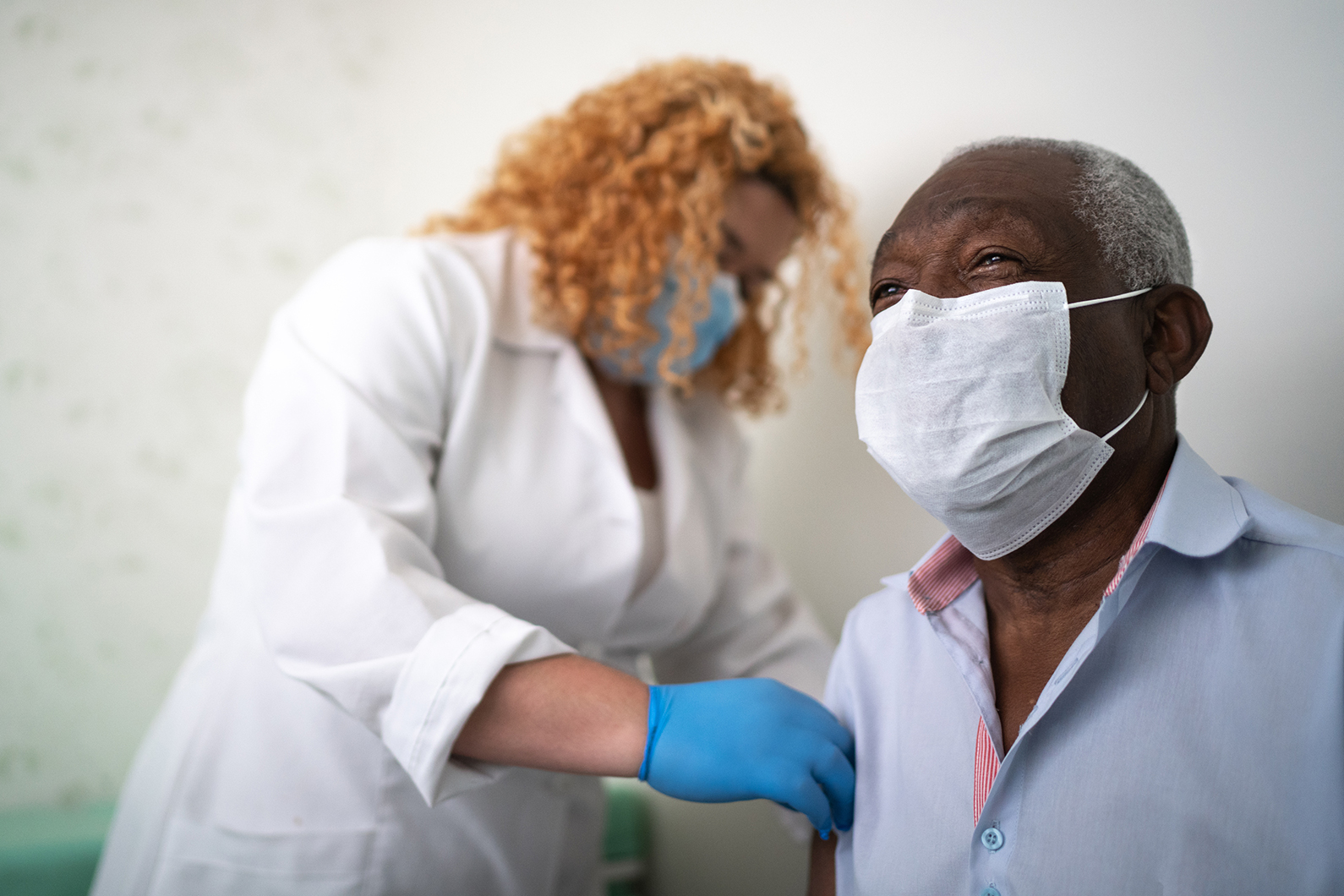 Older man getting vaccinated